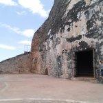 Tall walls, made of dark stone.