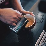The barista making the latte art