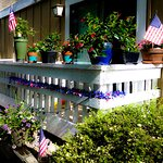 A guest adorns their patio with flowers for the fourth of July.
