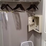 Closet with laundry basket, humidifier, and in-room safe. Extra pillows and blanket.