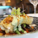 Cormeal-crusted cod w/ Cajun sofrito, potatoes Lyonnaise, braised fennel & tomato and pesto aiol