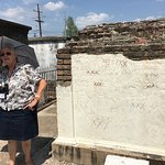 Martha at a tomb with Voodoo markings, explaining what they mean and why some cause damage.