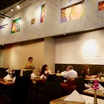 The restaurants high ceilings, warm lighting, and decorative walls provide an inviting atmospher