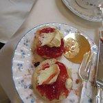 clotted cream, strawberry jam and warm scones; delicious