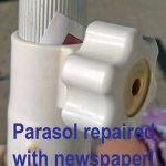 Parasols often had to undergo running repairs, with newspaper!