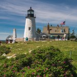 Visitors explore the grounds of Pemaquid Point Lighthouse.