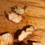 Chicken sliced in half to reveal white striated center