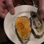 Oysters--dressed ina crumbled spinich