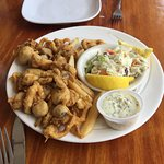 Fried clams, french fries, coleslaw and tartar sauce
