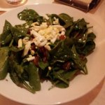 Spinach salad made at the table