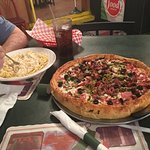 Chicago style combination pizza and chicken alfredo.