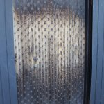 The back door with decorative patters. The more nails you displayed was an indicator of wealth.