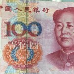 Fake 100 RMB note missing silver metallic vertical strip