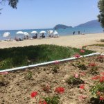This is a view of the beach and Ionian sea from the beach restaraunt