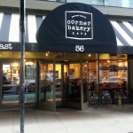front of, entrance to and outdoor seating at the Corner Bakery Cafe