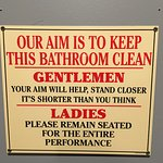 Sign by restrooms...