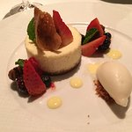 Crème Fraiche Cheesecake with Mixed Berries, Spiced Pecans and Lime-Basil Sorbert