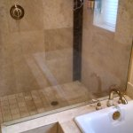 Huge walk in shower and large tub with window
