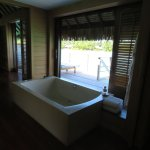 Windows over soaking tub open up to Lagoon views