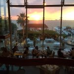 Upstairs overlooking seating area in and outside, and beautiful sunset