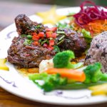 Caribbean stewed chicken with Rice en Beans, garden salad and sauteed vegetables.