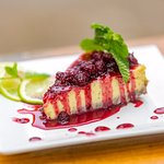 Lime pie with fresh blackberry compote.