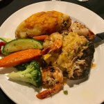 Filet with crab and jumbo grilled shrimp, stuffed baked potato and veggies
