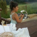My grand daughter playing the tamborine, playing with Kampfire Kevin