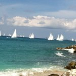 Portion of Beach and Heineken Regatta Sailboats seen from the beach