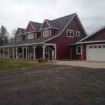 Front view of the B&B. Beautiful, relaxing front porch with a beautiful view of the grounds.