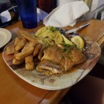 Pan sauteed red snapper with home fries and cilantro rice
