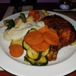 Main course - chicken quarter leg, veggies, mashed potatoes,  and skewered shrimp and veggies