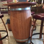 A wine table made from a barrel