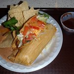 taco & tamale combination with salad and refried beans