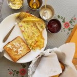 Delicious breakfast with honey, jam and a masala omelet! Highly recommend.