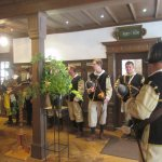 The hotel lobby was visited by a troop of singers.