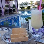 View from the poolside tables. Delicious pina colada, bread and olives!