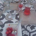 Free dessert alongside our bill! Raki, strawberry juice and strawberries