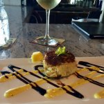 Crab cake appetizer is all crab meat. Served with a mustard aioli & balsamic reduction.