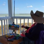 Local Artist painting on the lighthouse porch