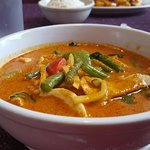 "Red Curry (came with a bowl of rice). The ""Hot"" level of spiciness was delicious and sinus-clear"
