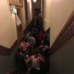 Ghost hunters in the hallway of the haunted hotel