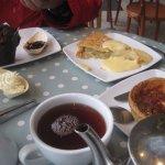 Chocolate muffin, warm apple pie with custard, quiche.
