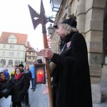 The Night Watchman gathers all on the Rathaus steps