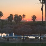 Sunrise view from partial ocean view room. Adults pool pictured