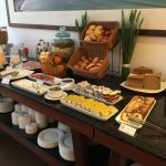 A superb breakfast with fresh fruit, eggs, meat, bread and more