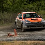Obligatory photo of me driving, taken by the staff photographer at DirtFish.