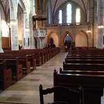 from the nave looks toward the screened choir loft