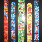 five stained glasses windows by Marc Chagall; center is Christ's life.