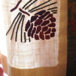 Apparently hand-stitched pine cone motif in the corner of each curtain panel